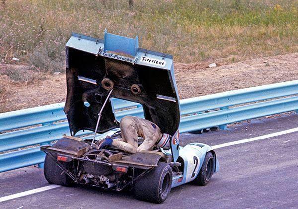 Le Mans Derek Bell fixing his Porsche 917K