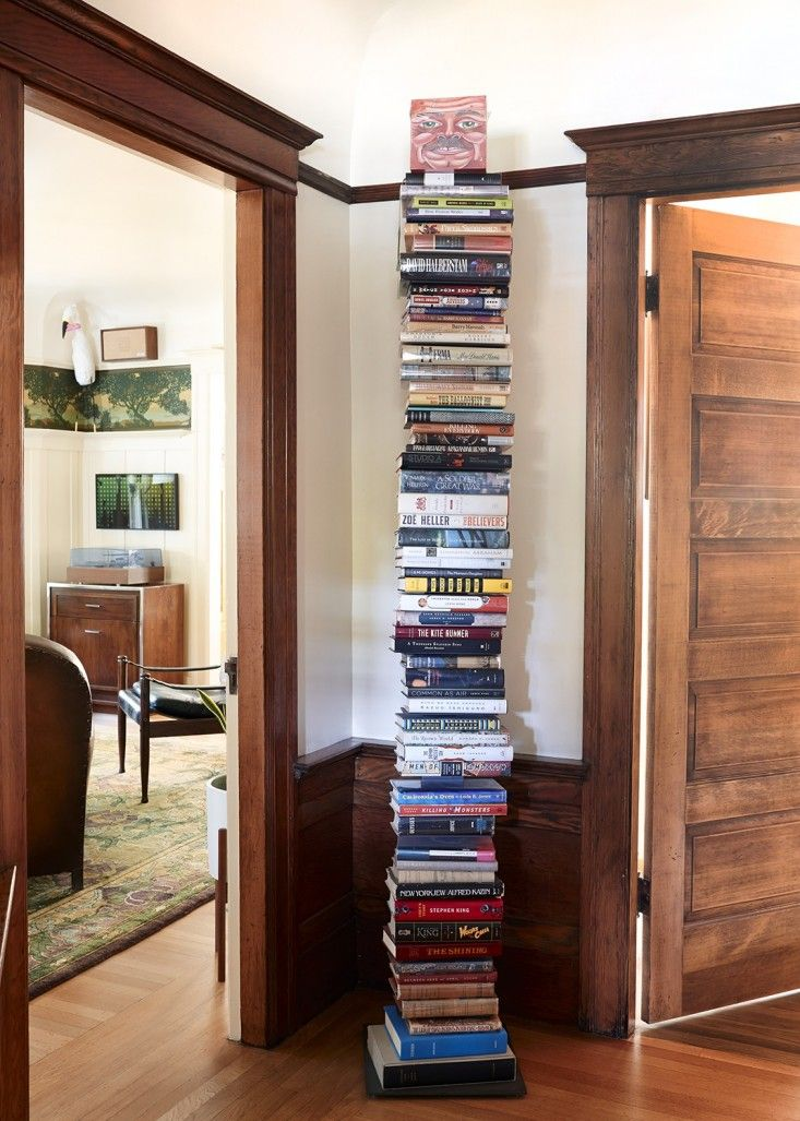 A tall stack of books in Ayalet Waldmen & Michael Chabon's Berkeley home.
