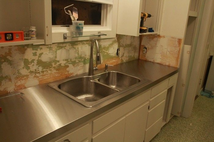 AHHH! I want this!!  DIY stainless steel countertop: Linn installs a $3,000 countertop for $400  - Retro Renovation