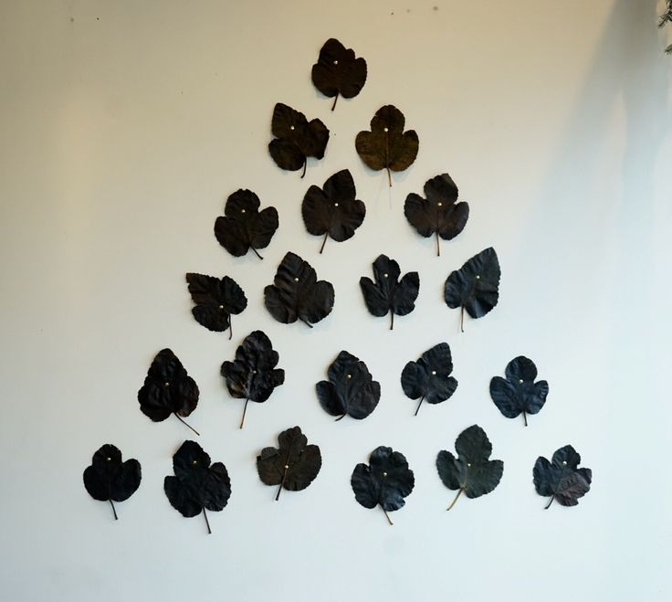 """Create a """"tree"""" of beautiful fallen leaves! We preserved these with Glycerine! 2/3 glycerine 1/3 water, enough to cover your leaves, dry for 2-4 days. We were pleasantly surprised as they turned into these dark brown soft leather versions of themselves. They called for a special display.  We tacked them on our white wall with gold old fashioned tacks in the form of a tree. Find more fun ideas at www.russianriverflowerschool.com  #russianriverflowerschool #floral #floraldesign #installations"""