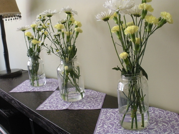 Nice decorating use of napkins and a great way to recycle old jam jars! LOVE fresh flowers for parties!!