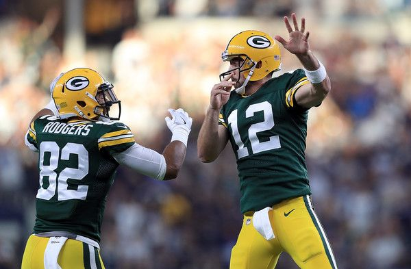 Aaron Rodgers Photos - (L-R) Richard Rodgers #82 and Aaron Rodgers #12 of the Green Bay Packers celebrate the game winning touchdown against the Dallas Cowboys in the fourth quarter at AT&T Stadium on October 8, 2017 in Arlington, Texas. - Green Bay Packers v Dallas Cowboys