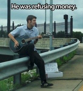 "faith in humanity restored his sign says ""I'm rich just singing"""