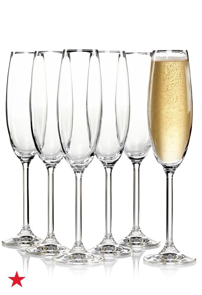 Toast to the New Year with these classic Lenox champagne flutes—equally suited for your  nest occasions or casual post-dinner drinks. Visit macys.com for more timeless stemware.