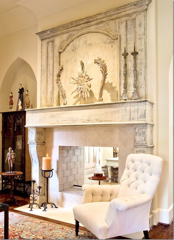 There's a large trumeau above the mantel which is decorated with a few water gilded pieces.  Limestone surround and beautiful stone bricks inside.   This is really, really beautiful.