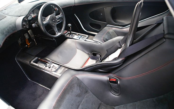 mclaren f1 interior the driver sits in the middle and there are two seats surrounding it. Black Bedroom Furniture Sets. Home Design Ideas