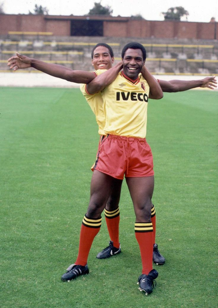 John Barnes (Watford FC, 1981–1987, 233 apps, 65 goals) and Luther Blissett (Watford FC, 1975–1983, 246 apps, 95 goals + 1984–1988, 127 apps, 44 goals + 1991–1993, 42 apps, 9 goals)