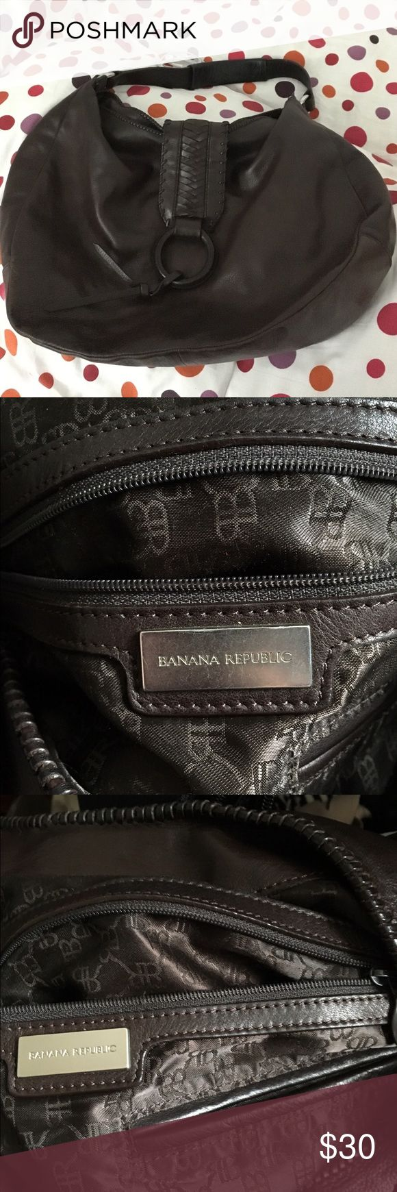 Banana Republic Saddle Bag/Hobo Better and stronger than a regular tote bag, this Dark Brown leather Banana Republic Hobo bag will carry everything! Featuring a zip pocket and cell phone pocket with a cloth liner embroidered with Banana Republic's initials. The leather exterior and strap are pristine, no scuffs or visible stains. Very good condition, and built to last! Banana Republic Bags Satchels