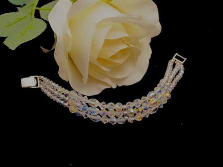 """Blingz the Thing Store - Triple Glitz, $69.99 (http://www.blingzthething.com/products/Triple-Glitz.html) This gorgous triple strand of Swarovski & Preciosa AB crystals accented with sterling silver for a delicate, yet eye-catching bracelet Length approx 7.5"""""""