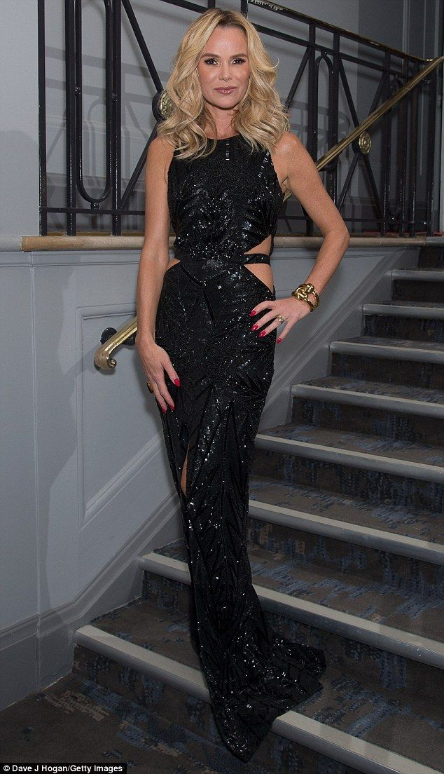 The lady is a vamp! Amanda Holden making a show-stealing appearance in a sexy cut-out gown at the Animal Hero Awards on Wednesday night