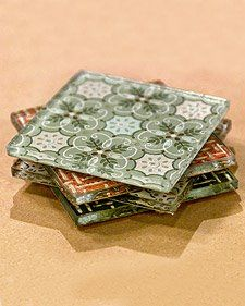 Leftover wallpaper on the back of glass for beautiful coasters... Or use fabric!