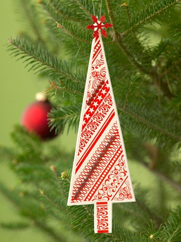 Patterned Paper Tree Ornament : Cut out a tree shape from festive holiday-motif cardstock. Mat the tree on white paper, then add rhinestone trim and a snowflake on top.