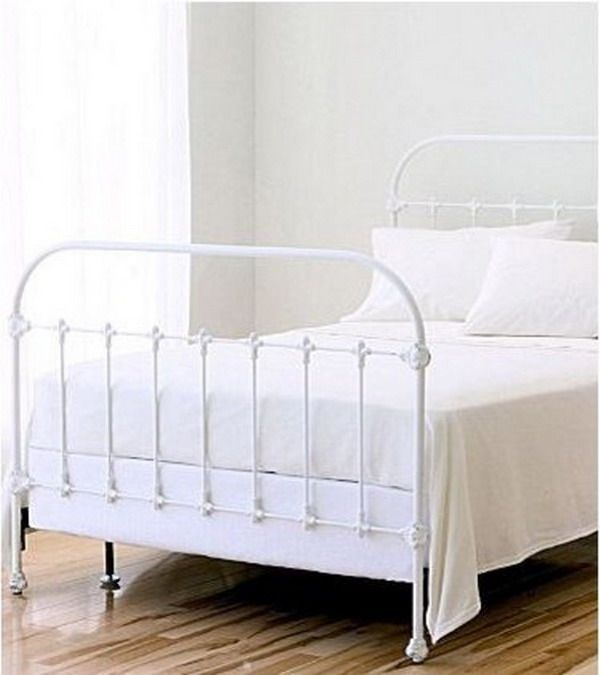 Classic Bedroom With White Metal Bed Frame