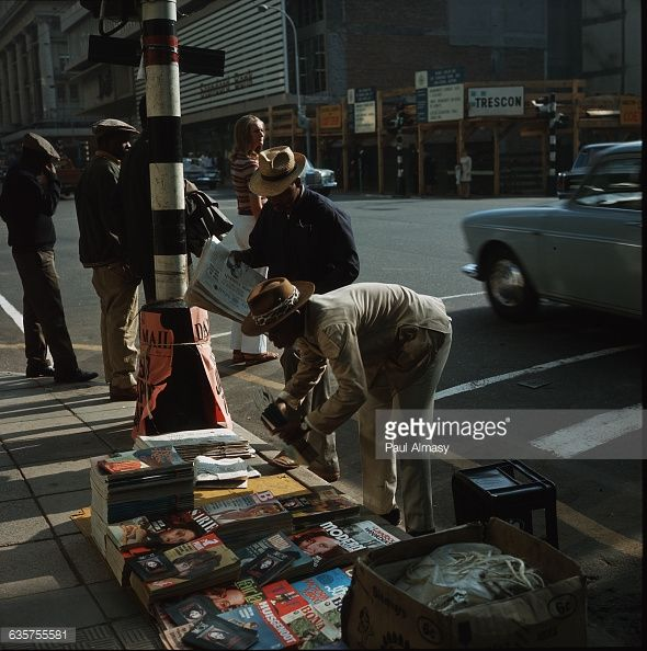 News Photo : A street vendor selling magazines in a northern...