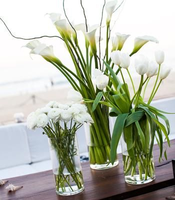 White and green centerpieces with callas, tulips and miniature roses