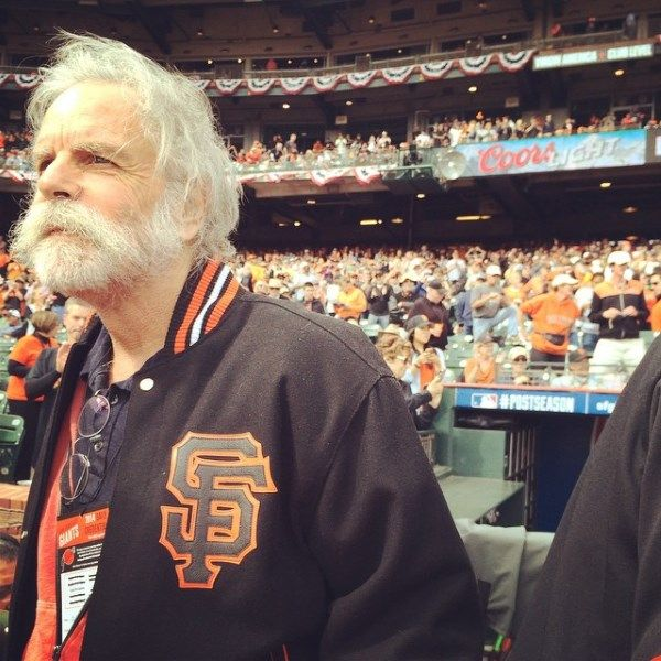 On Tuesday 10/14/14 afternoon Grateful Dead guitarist Bob Weir made his first public appearance since abruptly canceling all future tour dates, when he teamed with his Grateful Dead/Furthur band mate Phil Lesh and coach/musician Tim Flannery to sing the National Anthem at San Francisco's AT&T Park before the Giants took on the St. Louis Cardinals in Game Three of the National League Championship Series.
