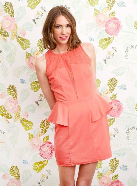 A Coral Peplum Bridesmaid Dress by Shop Lovely
