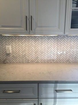 Dark Backsplash With White Cabinets