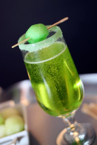 Sparkling Shamrock Champagne Cocktail 1 bottle of your favorite dry (Brut) champagne or sparkling wine (around 750 mL) 12 ounces of Midouri melon liqueur Honeydew melon pieces Green sanding or rimming sugar to garnish