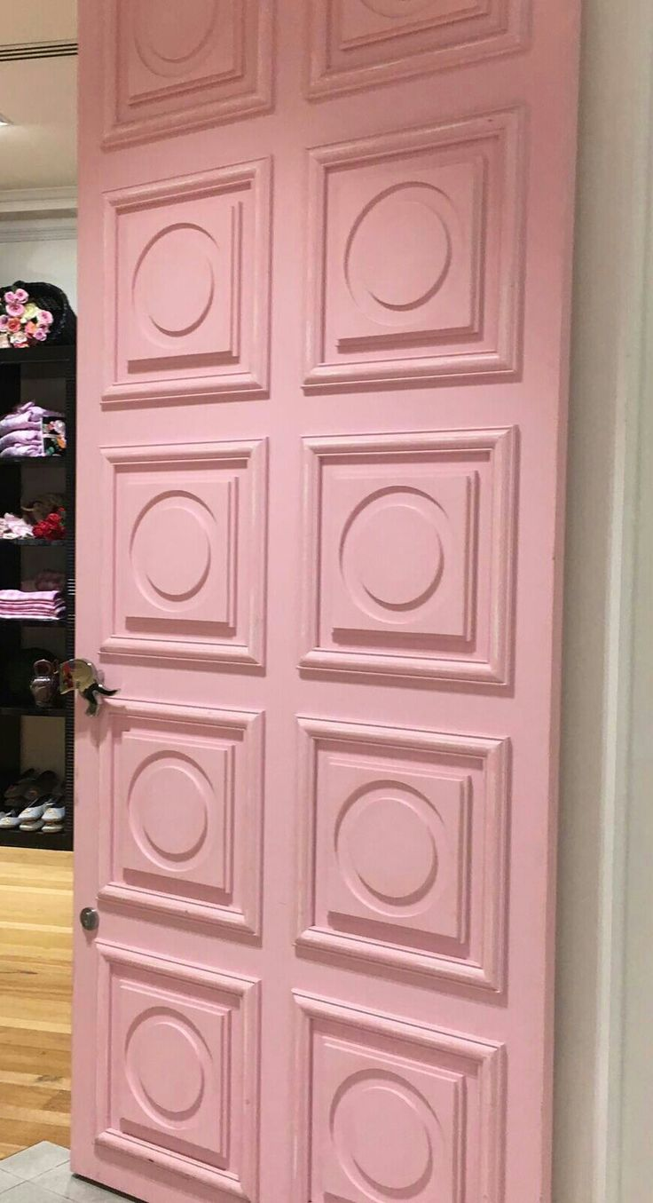 PHOTO 7: The door is a perfect match to the girly shop as it pink and the designs on it shows a very dollhouse door look.