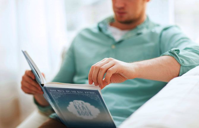 free book mock up man reading hardbound book