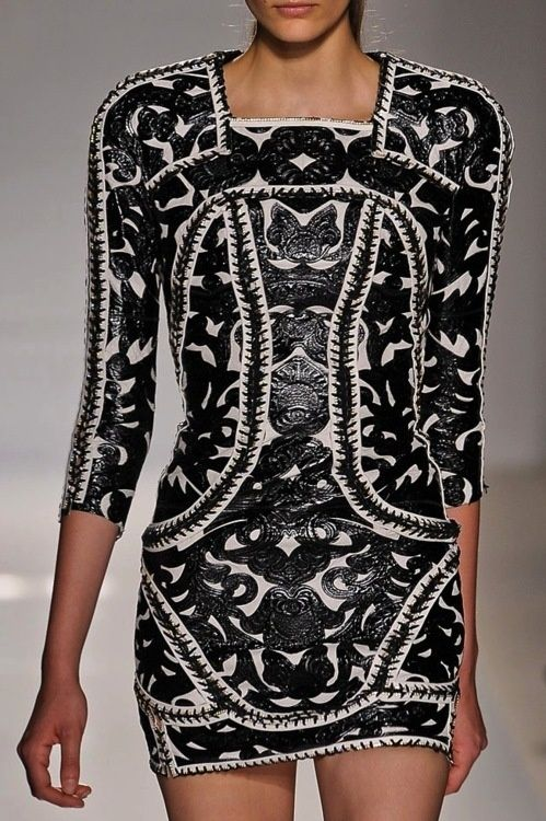 Balmain. I think this design is too short to wear as a dress but rather a top. It looks like textile with patterned leather.