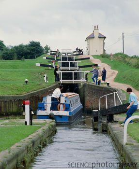 Canal boat going up Foxton Locks, Leics.