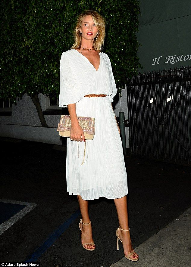 Elegant look: Rosie Huntington-Whiteley looked lovely in white as she celebrates her 28th ...