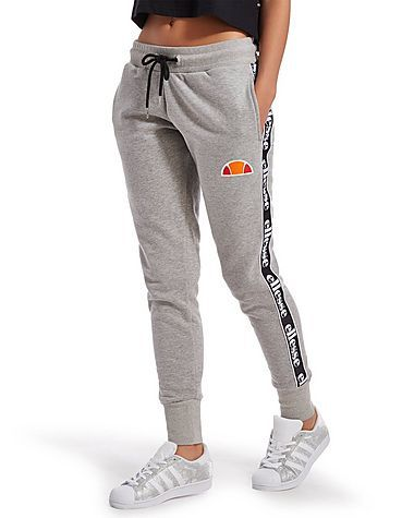 Old school swagger with a modern day twist, these exclusive women's Tape Fleece Pants from Ellesse are laid-back essentials built for chilling out in. In a classic athletic grey colourway, branded taping down the legs add retro style straight out of the '90s. With ankle cuffs for snug comfort, two side seam pockets make these perfect for relaxing in, while Ellesse's legendary logo adds the finishing touch.     Note: Sizes 4 and 6 do not feature a drawstring to the waist…