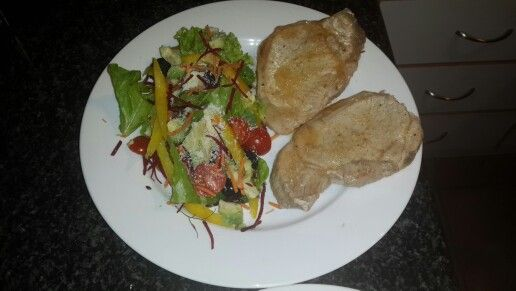 Pork shops with Nandos peri-pery, herb salad with black olives, avocado, baby tomatoes and parmasian cheese