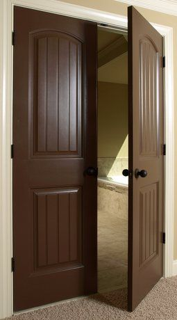 Dark stained interior wood doors including french doors leading into the dining room and formal living room.