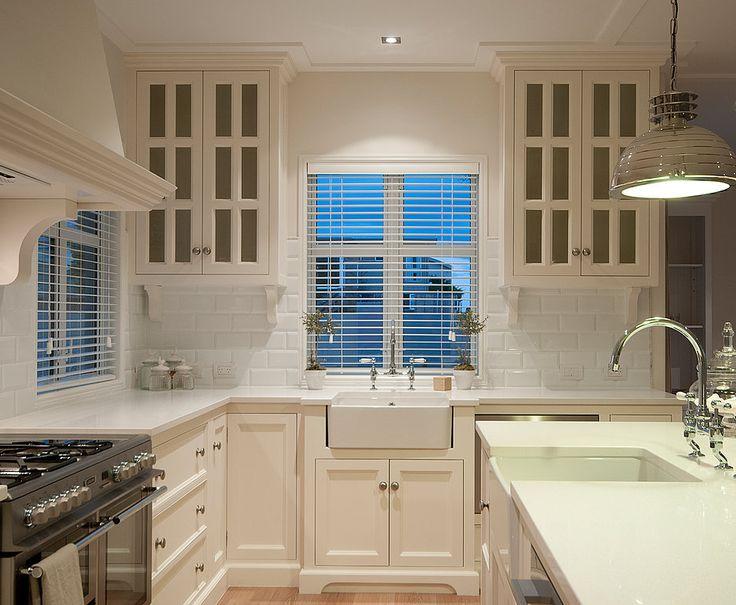 Source Paradise Building Development Gorgeous Monochromatic Kitchen With White Cabinetry Quartz Countertops And White Beveled Subway Tile Backsplash