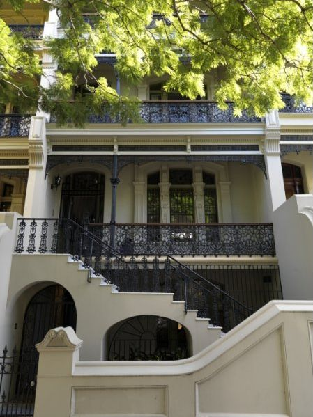 The exterior may be all Victorian era lacework but the interiors with its limed floors, soaring...