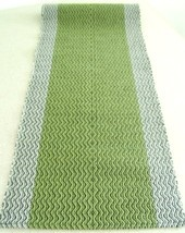 Hand woven light green- table runner (cotton / video cassette tape).