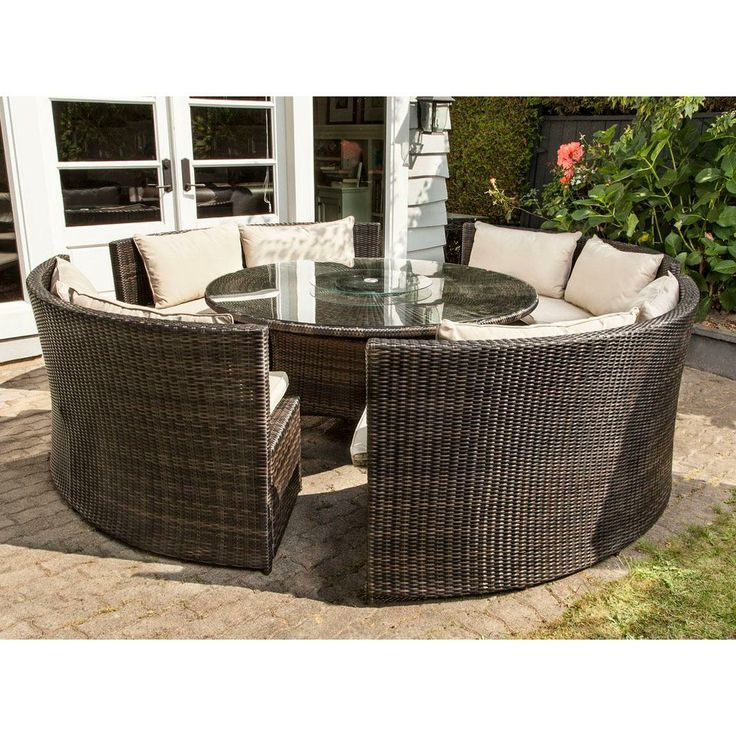 A Handmaid 5 Piece Outdoor Curved Bench Dining Set That Looks Like It S Made Of
