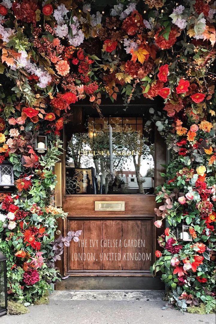 The Ivy Chelsea Garden In London United Kingdom Modern British Menus Served In A Refined Art Filled Space W In 2020 Flower Installation Autumn Garden Chelsea Garden