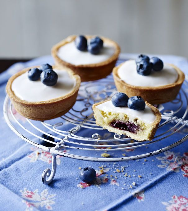 Baby Blueberry Bakewell Tarts ~ made with blueberry jam rather than the customary raspberry | showstopper bake by Jason White for GBBO s2e2 when he won Star Baker | recipe via BBC Food