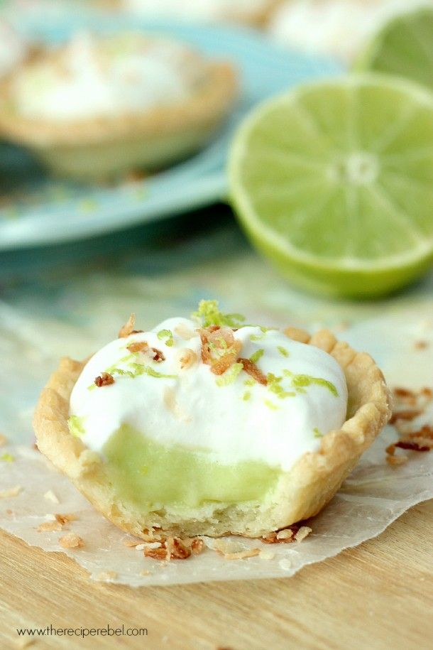 Coconut Lime Tarts: a light, creamy and refreshing lime filling topped with fluffy coconut cream! Easily dairy free. Perfect for Spring or Cinco de Mayo! www.thereciperebel.com