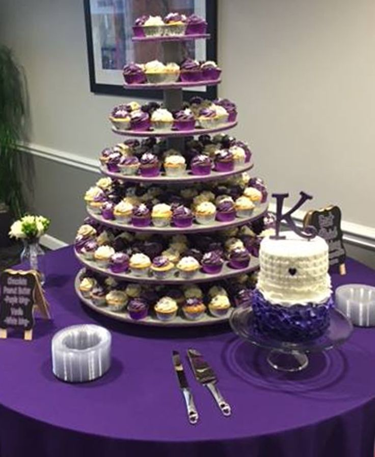 Royal purple wedding idea: cupcake tower instead of cake, but make the purple ones alternate to give it pop. The sign on the table is cute, too.