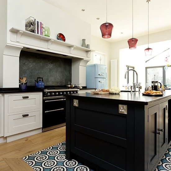 Open Oven In Kitchen: Open-plan Kitchen With Black Island And Range Cooker