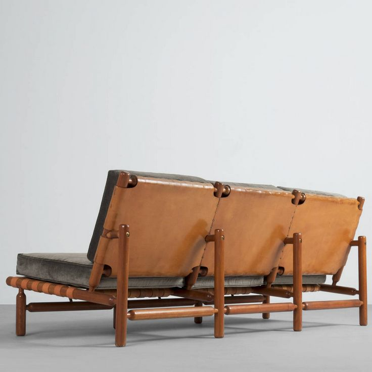 Ilmari Tapiovaara; Teak and Leather Sofa for La Permanente Cantù, 1957.