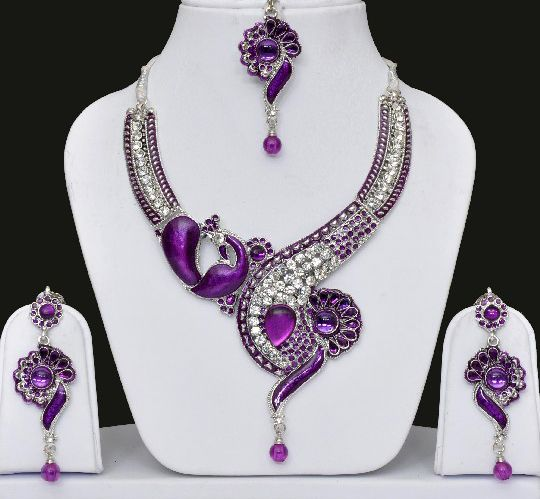 Peacock Indian Jewellery Set With Necklace, Indian Earrings Maang Tikka Studded with sparkling and shining golden purple color stones meenakari all over.