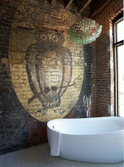 modern bath, owl and moon painted on brick  wall