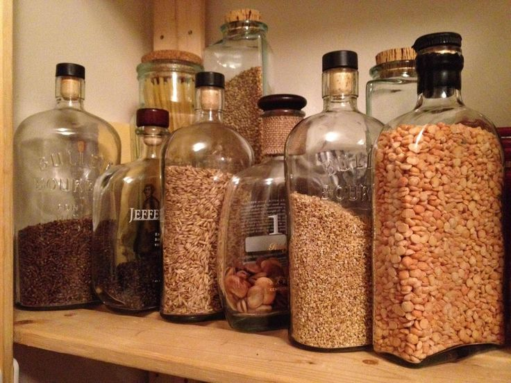 Good use for old bourbon bottles- Will need a funnel but very cute way to store rice, beans, and other stuff.