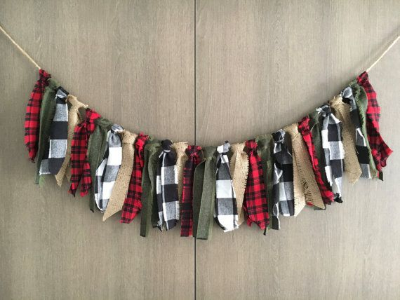 Lumberjack Party Fabric Garland, Plaid Burlap Banner, Party Decor Photo Prop, Country Christmas Garland, Flannel Garland  For all you flannel lovers, this banner is the perfect addition to any country/camping/lumberjack themed party or home. The warm combination of flannel plaids, forest greens and rustic burlaps are what make it so unique! The fabrics are hand tied to ¼ inch Jute Rope to the distance of about 3ft long for a total length of over 6ft - so you can tie it up anywhere. The edges…