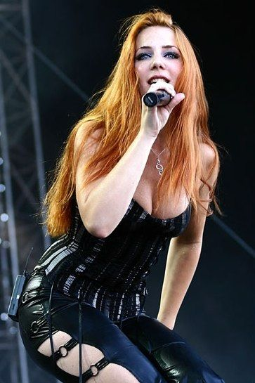 Simone Simons (born January 17, 1985) is a Dutch mezzosoprano and the vocalist of symphonic metal band Epica. That red hair though!!