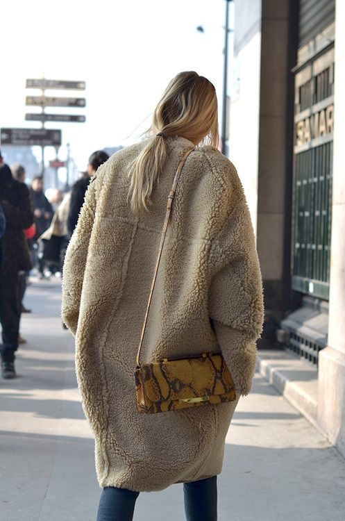 .Beige sheepskin cocoon coat....low pony tail. Skinny jeans.  Mustard gold snake skin bag.