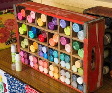 """Out-of-the-Ordinary Paint Holders Rather than having a mess of paint bottles cluttering her workspace, Erikia turned the supplies into tidy dots of color in vintage soda boxes. She groups them by hue to make them easier to locate -- and nicer to look at. """"It's less busy this way,"""" she says."""