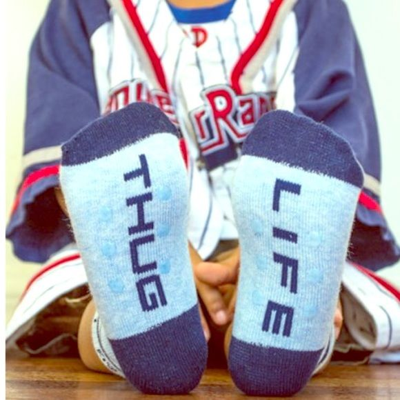 """""""Thug Life"""" Kids AG socks 4 pk SZ M & L available """"Thug Life""""- """"Little AG"""" at top of socks for Arthur George by Rob Kardashian. Size 2-4 T. So stinking cute. Includes 2 pairs new in package. Price firm unless bundled. Free gifts with purchase & 15% bundle discounts. ⭐️⭐️⭐️⭐️ALLOW 2 weeks to ship, so let me advance if you are interested in purchasing!! I am running low. ⭐️⭐️ Thanks. ❤️Steph Arthur George Accessories Socks & Tights"""