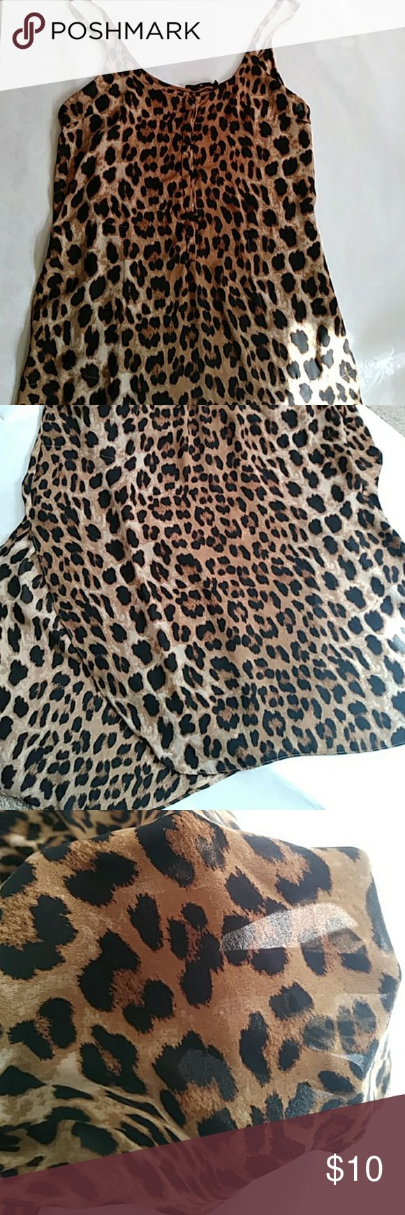 Sheer Cheetah Print Dress/Bathing Suit Cover Olivaceous brand sheer cheetah print dress or bathing suit cover.  Fits just below knee length with slits up both sides and small side pockets at hip.  Speghetti strap with button up top Olivaceous Swim Coverups